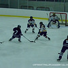 Katerina Toffoloni '15 sneaks the puck by an opponent.