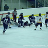 Co-captain Rivard '12 dives to cover up the puck and stop play.