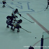 Greer McBeth '12 pushes herself between two BB&N opponents to gain control of the puck.