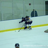Andover tries to take control of the puck along the boards.