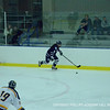 Co-captain Brooke VanValkenburg '12 speeds down the ice.