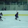 Evagelia Toffoloni '15 looks down the ice for an open teammate.