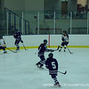 Andover passes the puck to an open opponent.