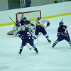 Rivard '12 gets low for the shot, while Evagelia Toffoloni '15 and Katerina Toffoloni '15 chase a BB&N player.