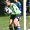 Emily Hoyt '13 saves a shot during pre-game drills.