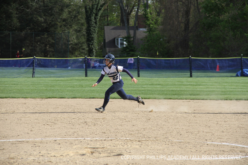 Mendez '13 bolts down the path to third base.