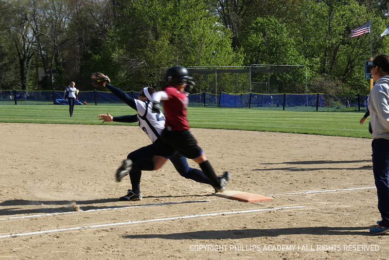 Caitlin Clancy '13 stretches out for the ball to ensure the runner is out.