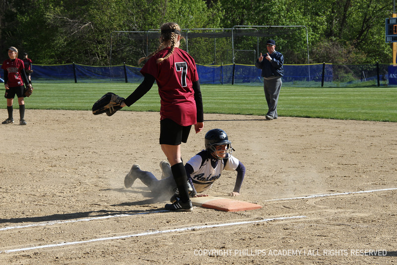 Mendez '13 smiles as she slides back into first.