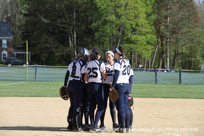The Big Blue huddle up on the mound before the start of the inning.