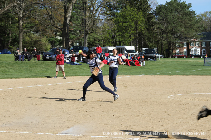 Nasser '15 fields the bunt and fires it to first to get the runner out.