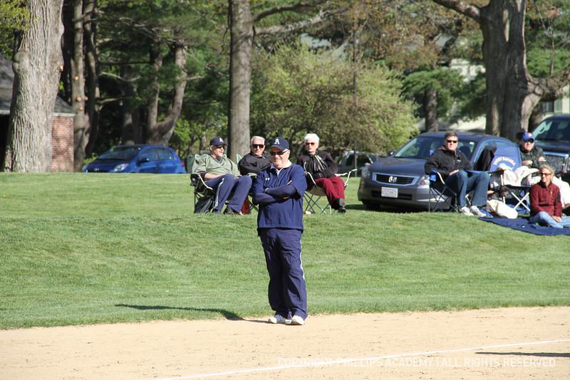 Head Coach Peter Drench coaches third base.