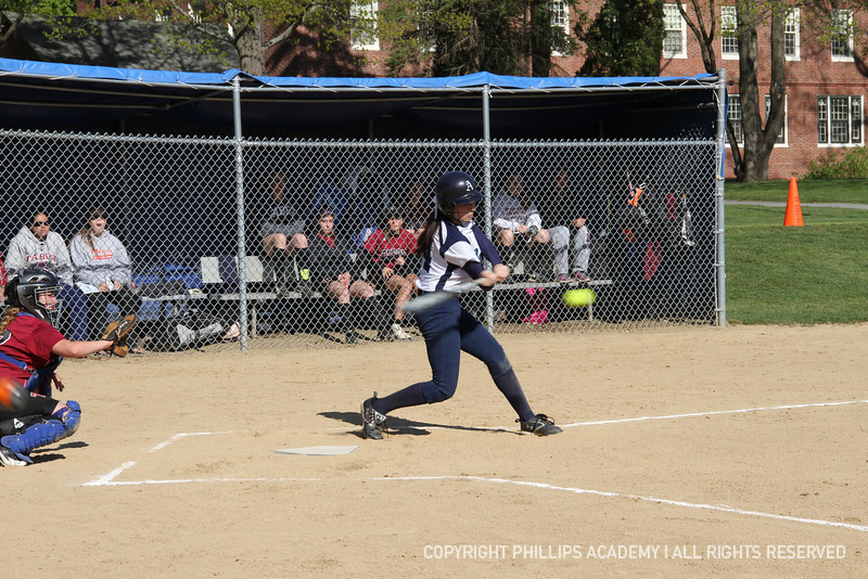 Co-captain Abby Chung '13 pounds the ball to left field.