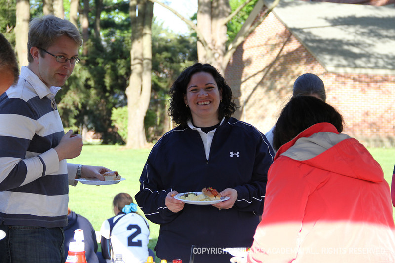 Rachel Bain '98 smiles for the camera as she gets some food!