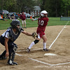 Nikki Pelletier '13 frames an outside pitch.