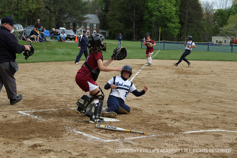 Co-captain Maloney '13 slides into home off of an RBI.