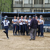 Andover gathers around home plate as Maloney '13 chargers in to score on her out of the park homer.