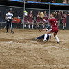 Kristin Mendez '13 slides into home as she steals on a passed ball to score a run.