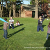Hartung '14 and Bradford '15 play wiffle ball with the kids.