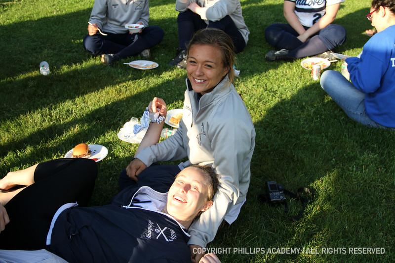 Co-captain Maloney '13 enjoys some food with Skwierczynski '12.