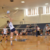 Andover slaps the ball over the net.