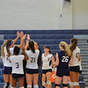 Coach Beckwith goes around giving high-fives to his players after a great set...