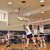 Andover tips the ball over the net.