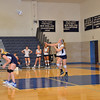 The big blue launches the ball to the other side of the net for Choate to handle.