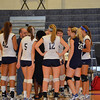 During a TO, the girls gather up and listen to coach Beckwith's advice.