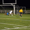 Sam Hewat '12 scores the first goal of the night.