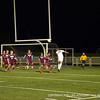Jonathan Westling '12 uses his head to direct the ball towards the net.