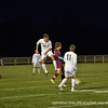 Jonathan Westling heads the ball away from NMH.
