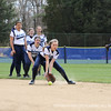 Hartung '14 keeps her glove down while fielding the ball.