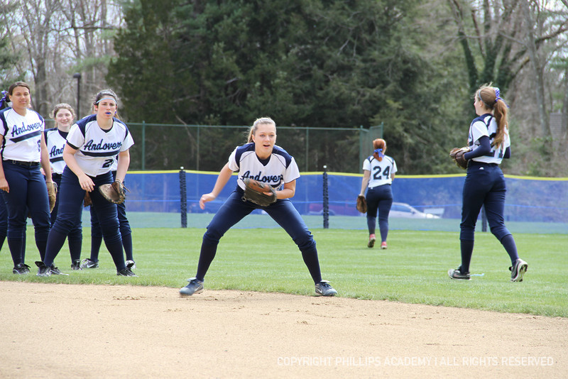 Hartung '12 gets down and ready for a ground ball.