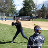Co-captain Kayla Maloney '12 takes some soft-toss throws during warm ups.