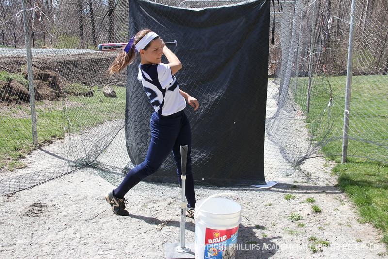Mendez '13 follows through on her swing.