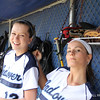 Hartung '14 and Mendez '13 have some fun in the dugout.