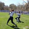 Ravenne Nasser '15 throws soft-toss to Mackenzie Bradford '15.