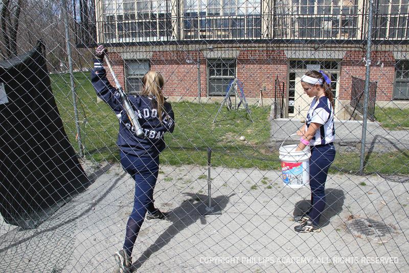 Kristin Mendez '13 feeds the tee for Sage Hunt '12.