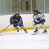 Mike Gallagher '20 wins the race to the puck.