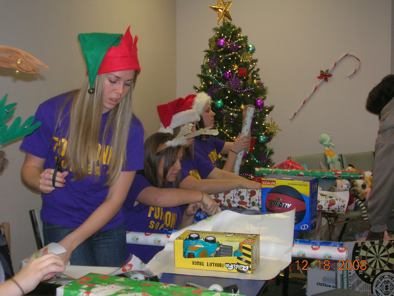 "Fontbonne University softball players volunteering at the Community Action Agency of St. Louis County's ""Winter Wonderland"" event."