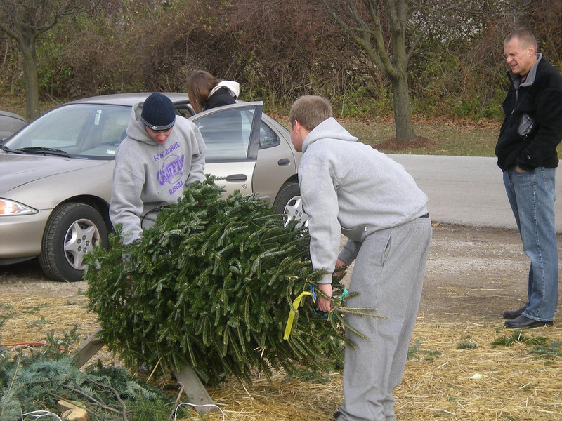 Fontbonne University baseball players volunteering at the Shinning Lights for Visually Impaired Children tree lot.