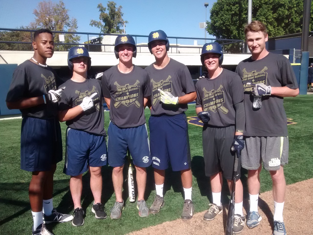 Some returning ND players sport their Mission League Champion T-shirts at baseball class in October 2015.