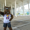 Damien, UAlbany's official mascot, keeps watch on the academic podium.  Photographer: Mark Schmidt