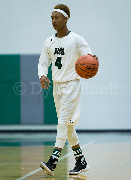 Dylan Buell | dylanphotog@gmail.com | @dylanphotog<br /> J'len Youngblood #4 of the Western Hills Wolverines takes the ball up the floor during the game at Lapsley Cardwell Gym Monday night.