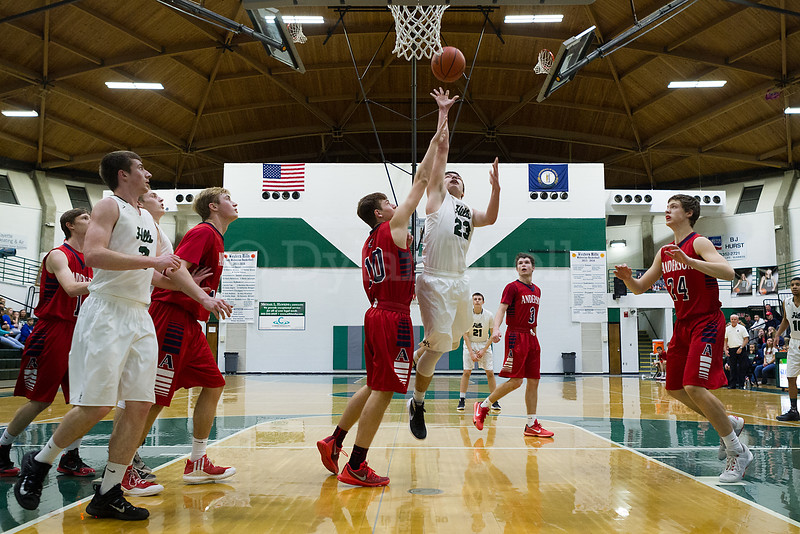 Dylan Buell   dylanphotog@gmail.com   @dylanphotog<br /> Cody Ross #23 of the Western Hills Wolverines attempts a layup during the game at Lapsley Cardwell Gym Monday night.