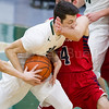 Dylan Buell | dylanphotog@gmail.com | @dylanphotog<br /> Matthew Peal #2 of the Western Hills Wolverines drives on Gunnar Gillis #4 of the Anderson County Bearcats during the game at Lapsley Cardwell Gym Monday night.