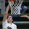 Dylan Buell   dylanphotog@gmail.com   @dylanphotog<br /> Keaton Anderson #15 of the Western Hills Wolverines attempts a layup during the game at Lapsley Cardwell Gym Monday night.