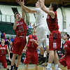 Dylan Buell   dylanphotog@gmail.com   @dylanphotog<br /> Matthew Peal #2 of the Western Hills Wolverines attempts a shot between Adam Hardin #21 and Christian Gritton #24 of the Anderson County Bearcats during the game at Lapsley Cardwell Gym Monday night.