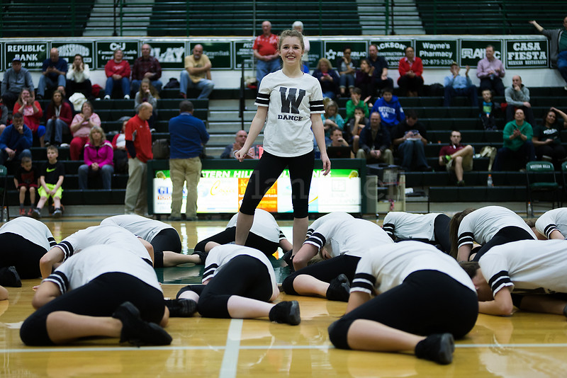 Dylan Buell | dylanphotog@gmail.com | @dylanphotog<br /> The Western Hills dance team performs during the game at Lapsley Cardwell Gym Monday night.