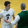 Dylan Buell   dylanphotog@gmail.com   @dylanphotog<br /> Matthew Peal #2 of the Western Hills Wolverines talks with head coach Geoff Cody during the game at Lapsley Cardwell Gym Monday night.